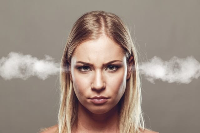 Woman with steam coming out of her ears