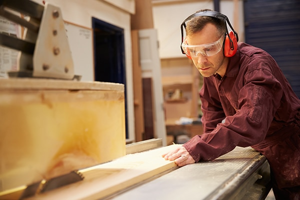 Man working with table saw