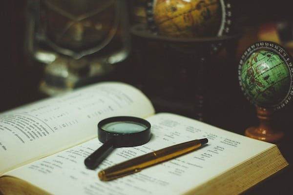 magnifying glass and an old book