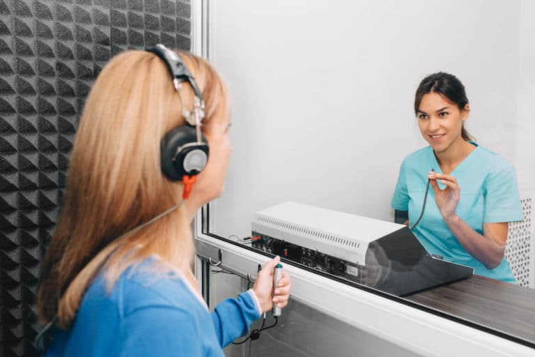 woman getting her hearing tested