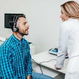 Man gets a hearing test.