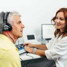 Man gets a hearing test.